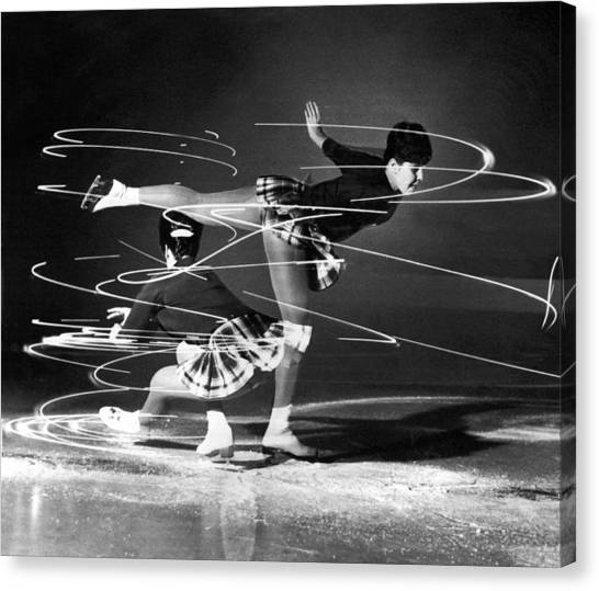 Acrobatic Canvas Print - Twirling Lights And Spins On Ice by Underwood Archives