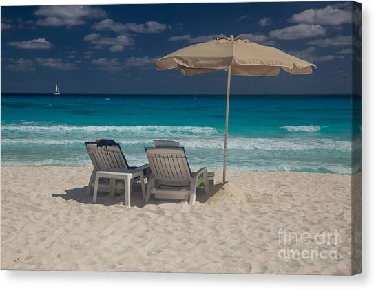 Catamarans Canvas Print - Two Beach Chairs On A White Sand Beach With Umbrella And Turquoi by Bridget Calip