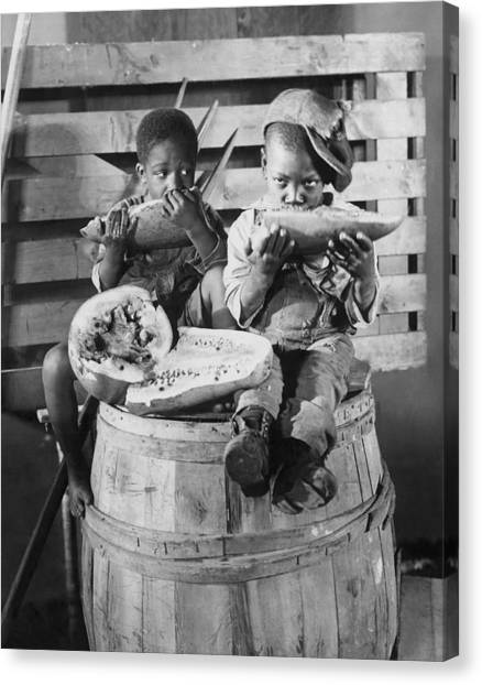 Black 7 White Canvas Print - Two Boys Eating Watermelon by Underwood Archives