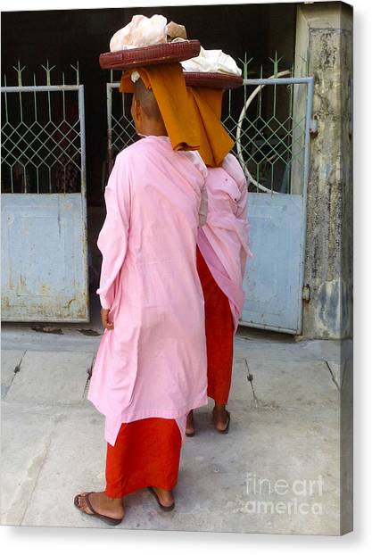 Two Buddhist Nuns Collecting Food Donation From Locals 75th Street Mandalay Burma Canvas Print by PIXELS  XPOSED Ralph A Ledergerber Photography