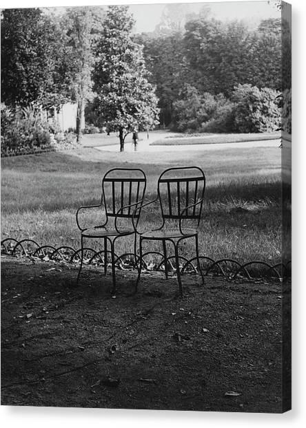 Two Chairs Near The Champs Elysees Canvas Print by Erwin Blumenfeld