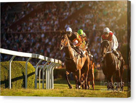 Thoroughbreds Canvas Print - Two Jockeys During Horse Races On His by Vladimir Hodac