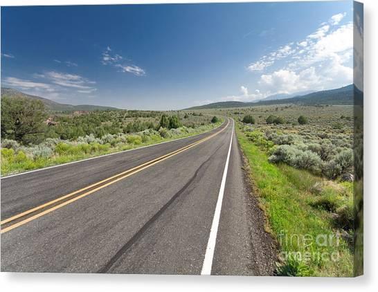 United Way Canvas Print - Two Lane Desert Road  by Jim Pruitt