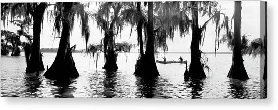 Atchafalaya Basin Canvas Print - Two Men Canoe Down The Mississippi by Robb Kendrick
