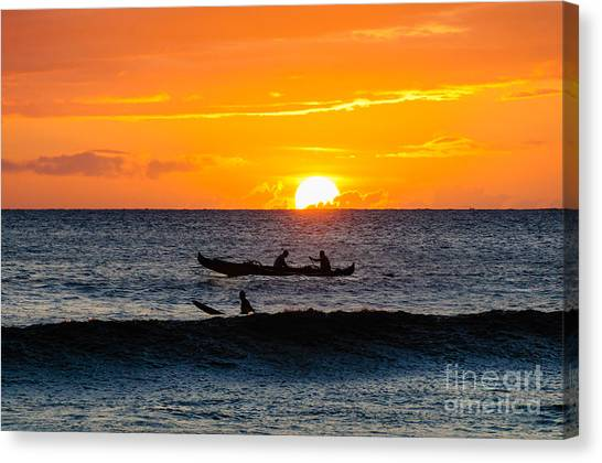 Two Men Paddling A Hawaiian Outrigger Canoe At Sunset On Maui Canvas Print