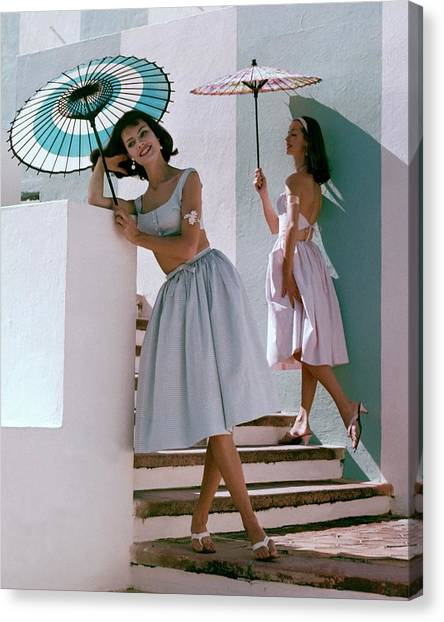 Two Models Posing With Parasols Canvas Print by Frances Mclaughlin-Gill