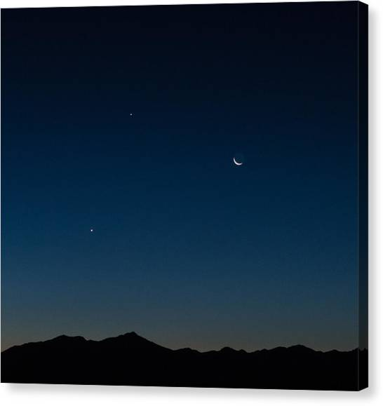 Two Planets And A Moon Canvas Print