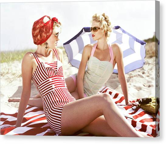 Two Retro Young Women On Beach Canvas Print by Johner Images