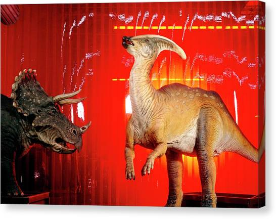 Two Robotic Dinosaurs Canvas Print by Peter Menzel, Dinamation/science Photo Library