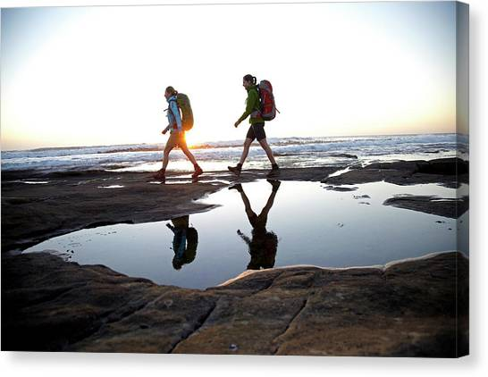 Cape Town Canvas Print - Two Women Are Hiking At Sunset by Lars Schneider