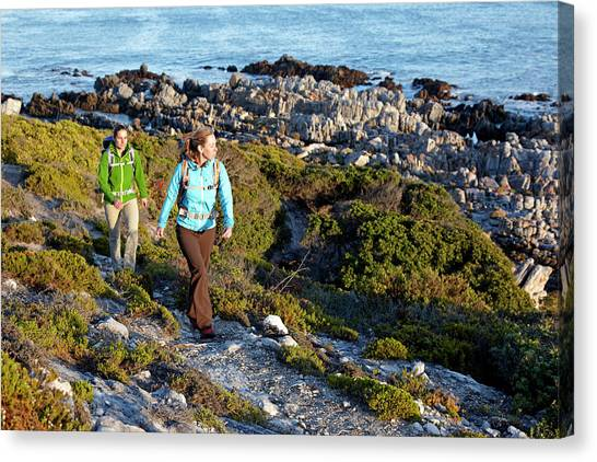 Cape Town Canvas Print - Two Women Hiking On An Ocean Trail by Lars Schneider
