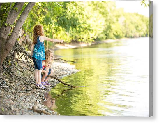 Two Young Girls Playing On Bank Of Mississippi River Canvas Print by Emholk