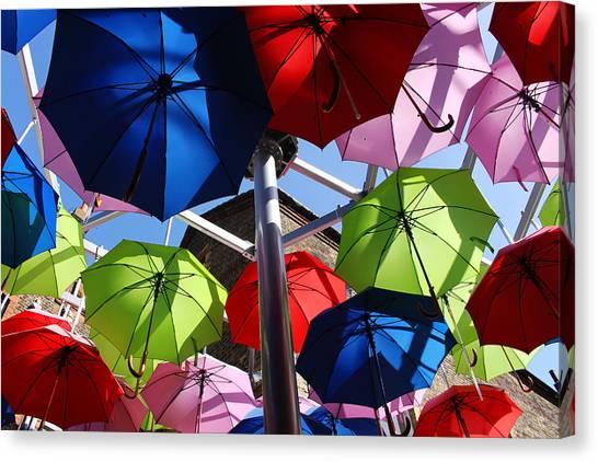 Umbrellas In The Sky Canvas Print