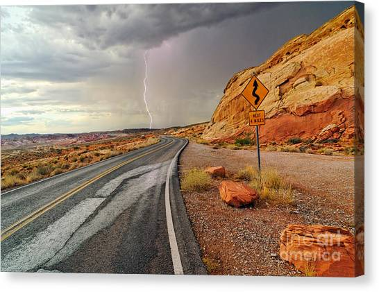 Mojave Desert Canvas Print - Uncertainty - Lightning Striking During A Storm In The Valley Of Fire State Park In Nevada. by Jamie Pham