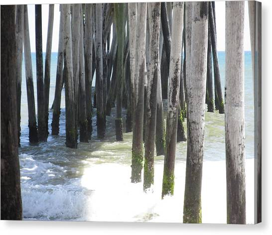 Under The Pier Canvas Print by Cheryl Smith
