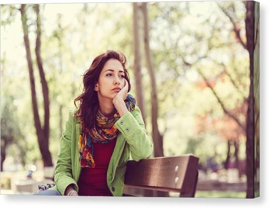 Unhappy Girl Sitting At Bench Canvas Print by Martin Dimitrov