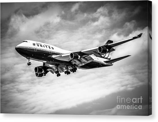 Airplanes Canvas Print - United Airlines Airplane In Black And White by Paul Velgos