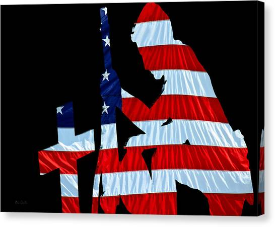Special Forces Canvas Print - A Time To Remember United States Flag With Kneeling Soldier Silhouette by Bob Orsillo