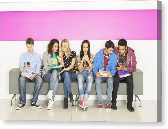 University Students Sitting On Bench Canvas Print by Robert Daly