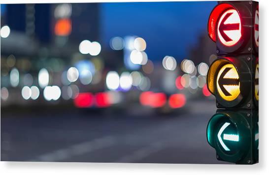 Urban City Street Szene With Colorful Traffic Lights And Bokeh Night Lights Canvas Print by Matthias Makarinus