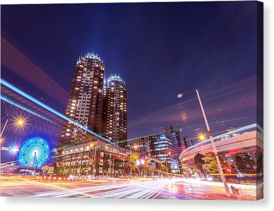 Urban Night View At Tokyo Ariake Canvas Print by Photography By Zhangxun