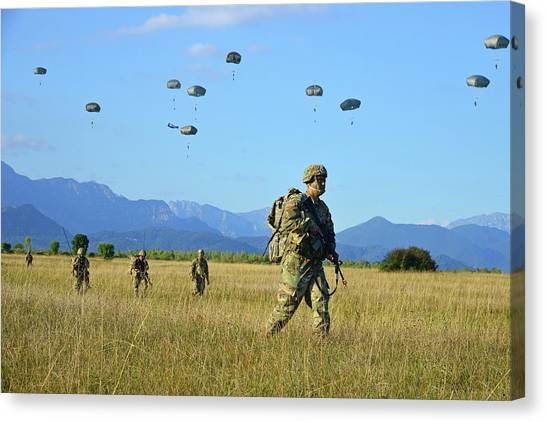 Nato Canvas Print - U.s. Army Paratroopers Move Toward An by Stocktrek Images