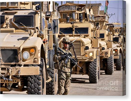 Nato Canvas Print - U.s. Army Soldier Stands Local Security by Stocktrek Images