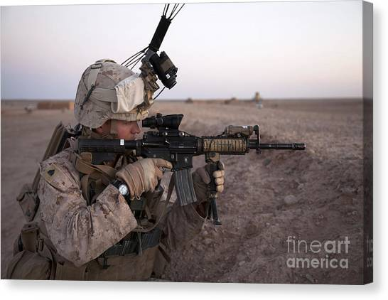 Nato Canvas Print - U.s. Marine Provides Security At Camp by Stocktrek Images