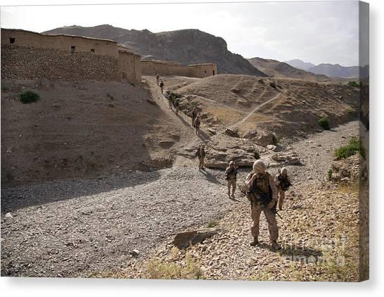 Nato Canvas Print - U.s. Marines Patrol Through A Village by Stocktrek Images