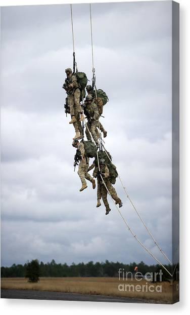 Green Berets Canvas Print - U.s. Soldiers Are Lifted Off The Ground by Stocktrek Images