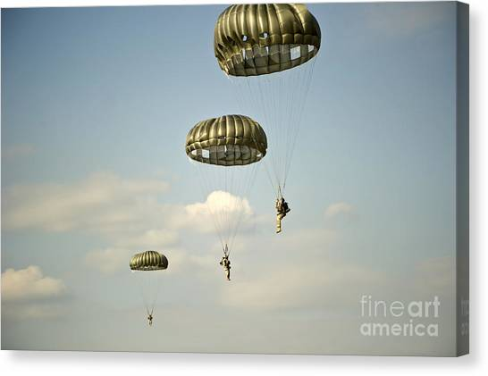 Green Berets Canvas Print - U.s. Soldiers Descend Through The Sky by Stocktrek Images