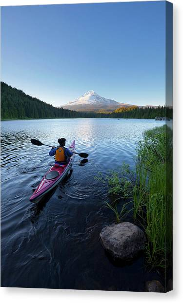 Kayaks Canvas Print - Usa, Oregon A Woman In A Sea Kayak by Gary Luhm
