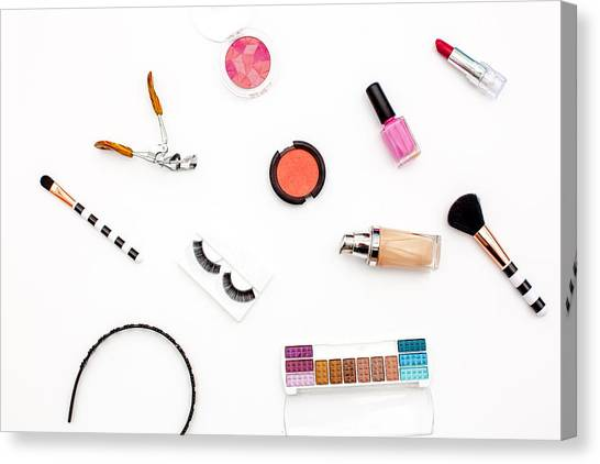 various makeup products and cosmetics in white background.Top view Canvas Print by Carol Yepes