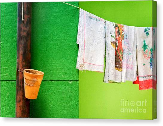 Colorful Canvas Print - Vase Towels And Green Wall by Silvia Ganora
