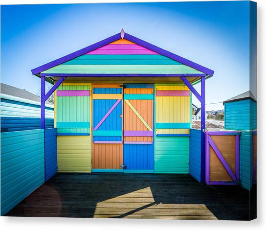 Canvas Print featuring the photograph Vibrant Beach Hut by Gary Gillette