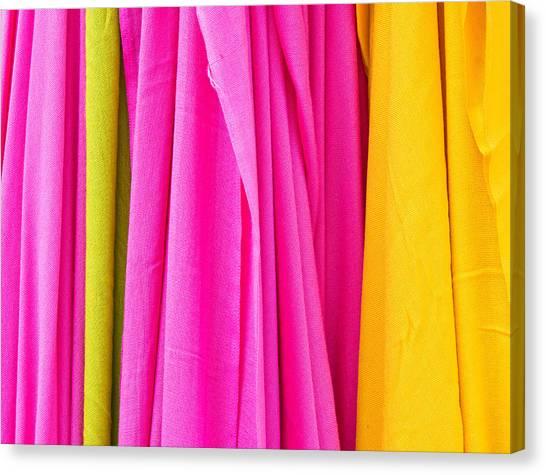 Clothing Store Canvas Print - Vibrant Cloths  by Tom Gowanlock