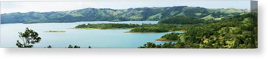 Arenal Volcano Canvas Print - View Of Lake In Arenal Volcano National by Panoramic Images