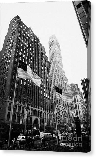 Manhatan Canvas Print - view of pennsylvania bldg nelson tower and US flags flying on 34th street new york city by Joe Fox