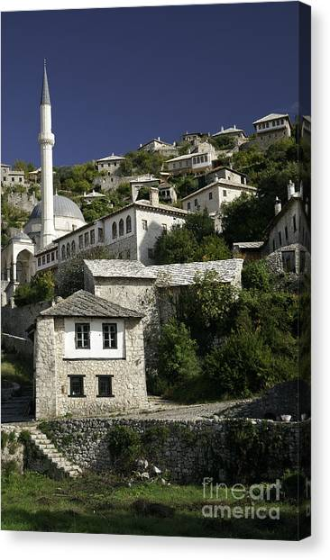 views of pocitelj in Bosnia Hercegovina with minaret bridge and river Canvas Print