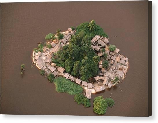 Congo River Canvas Print - Village Huts Crowd A Small Island by Robert Caputo