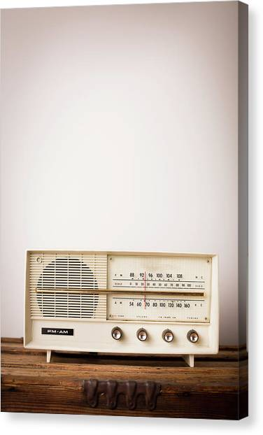 Vintage Beige Radio Sitting On Wood Canvas Print