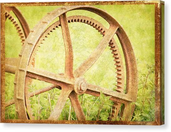 Vintage Rusty Wheel Canvas Print by Lesley Rigg