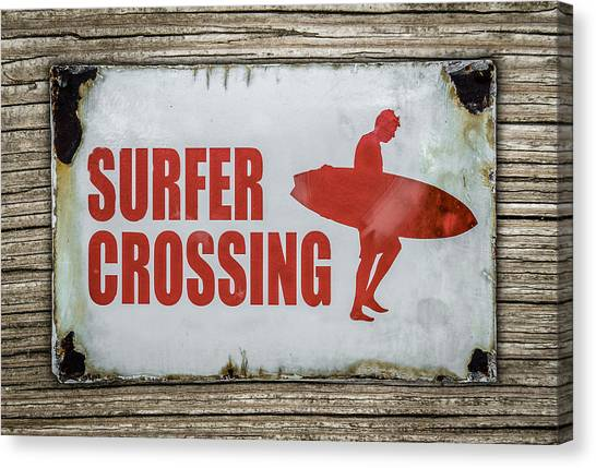 Surf Canvas Print - Vintage Surfer Crossing Sign On Wood by Mr Doomits