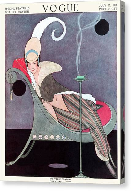 Vogue Cover Featuring A Woman Sitting In A Chair Canvas Print by Helen Dryden