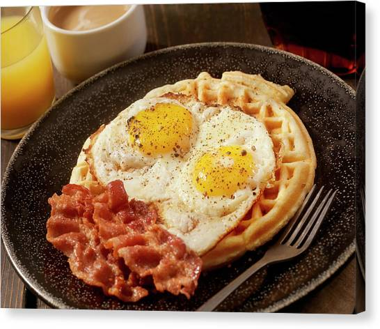 Waffles With Fried Eggs And Bacon Canvas Print by Lauripatterson
