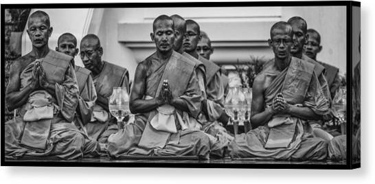 Wat Dhamma Monks Prayers Canvas Print by David Longstreath