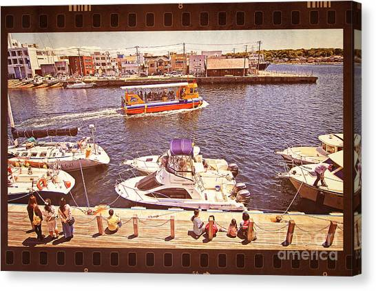 Watching Boats On The Port Canvas Print