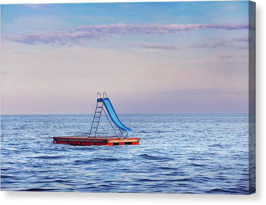 Water Slide On Raft In Ocean Canvas Print