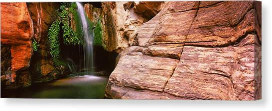 Caverns Canvas Print - Waterfall Rushing Through The Rocks by Panoramic Images