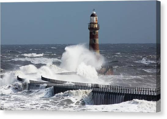 Sunderland Canvas Print - Waves Crashing Into A Lighthouse On The by John Short / Design Pics